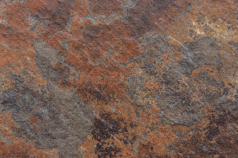 Old Distressed Brown Terracotta Copper Rusty Stone Background with Rough Texture Multicolored Inclusions. Stained Gradient stock image
