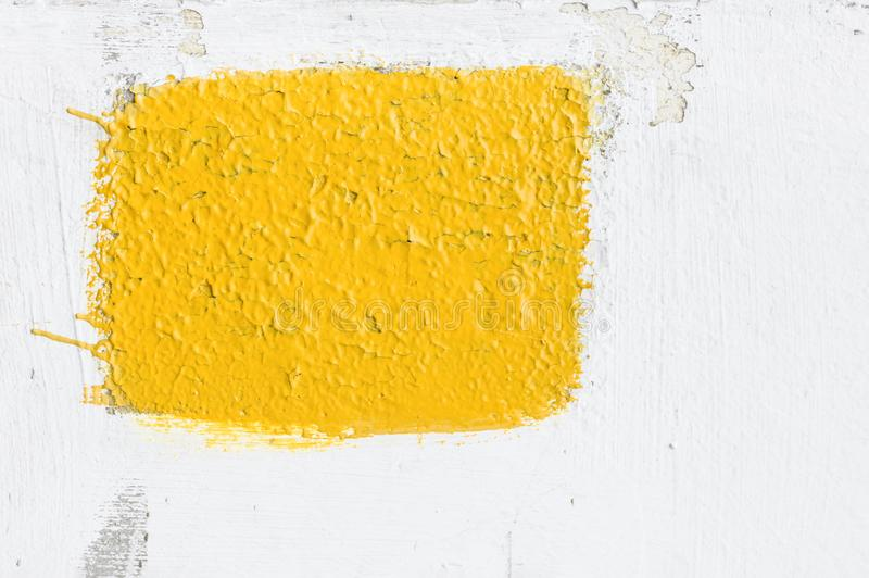 Old Distressed Cracked White Plaster Cement Wall with Painted Yellow Rectangle. Background Template Mockup Placeholder royalty free stock photography