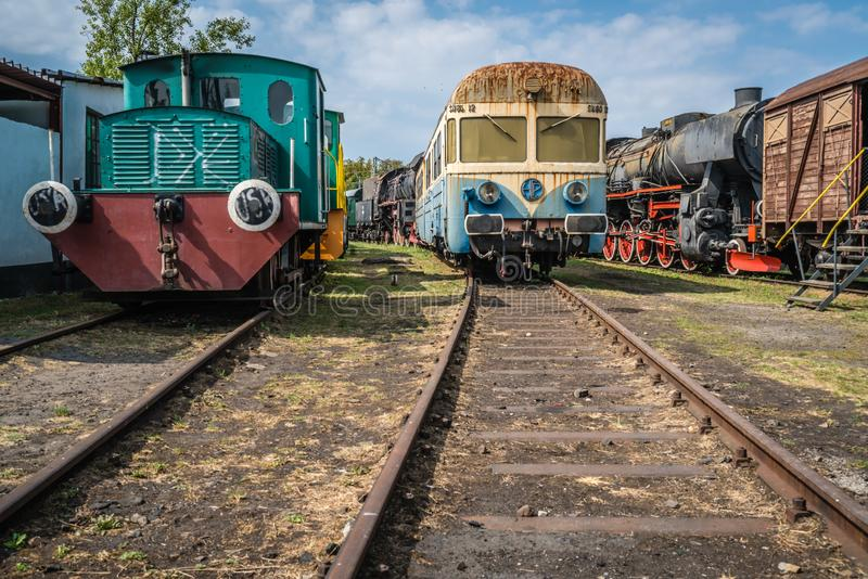 Old disused passenger trains. Old disused green, blue and yellow passenger trains on the side track in the Museum of Industry and Railway in Silesia, Jaworzyna stock photography