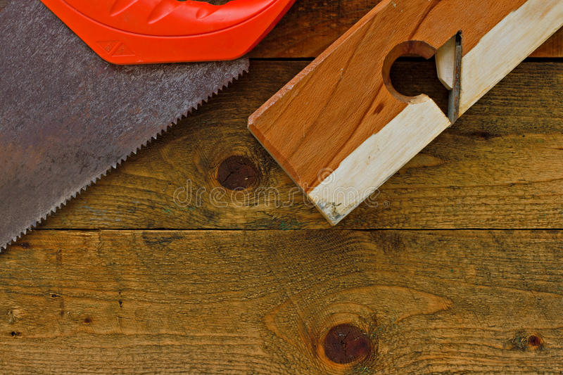 Old diy tools on rustic wooden work bench. Various old diy tools on rustic wooden work bench stock photos