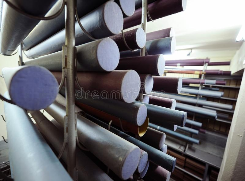 Old documents. Large number of rolled maps on a stand royalty free stock photos