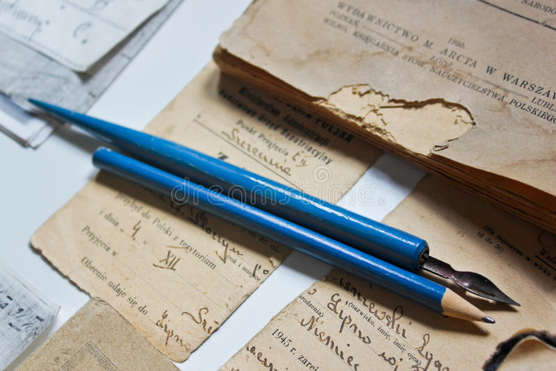 Old documents and writing instruments stock images