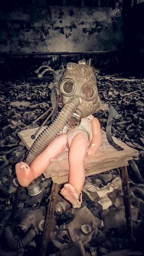 Old doll in a gas mask in an abandoned house Chernobyl Ukraine stock photos
