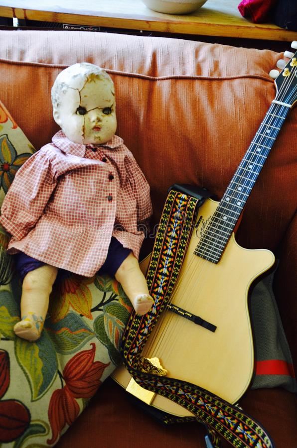 Old doll names sally. Beautiful old doll named sally wants to play the guitar royalty free stock photography