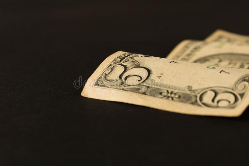 Old 5 dollar bill on dark background. Close up. The concept of saving money.  royalty free stock photo