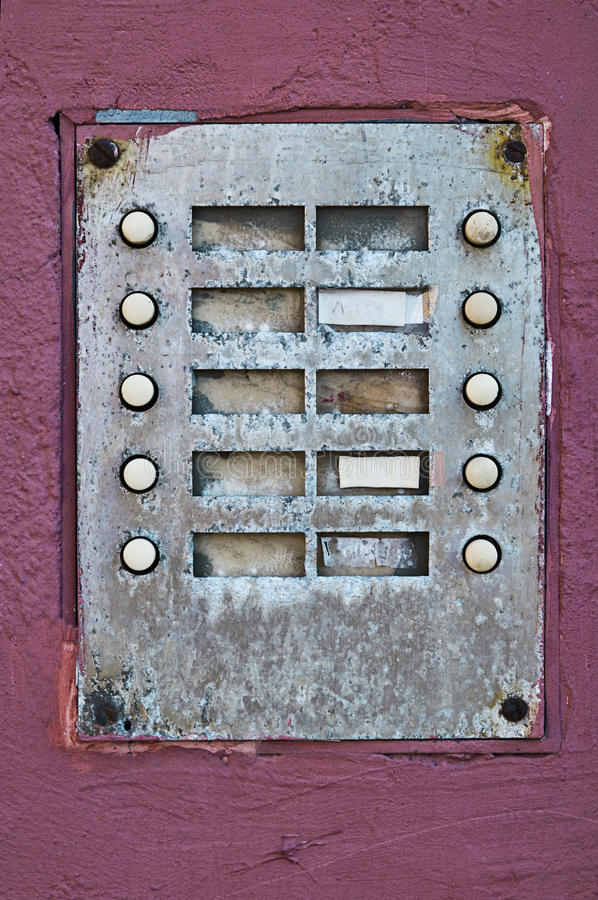 An old door bell with 10 buttons. And 10 text fields stock photos