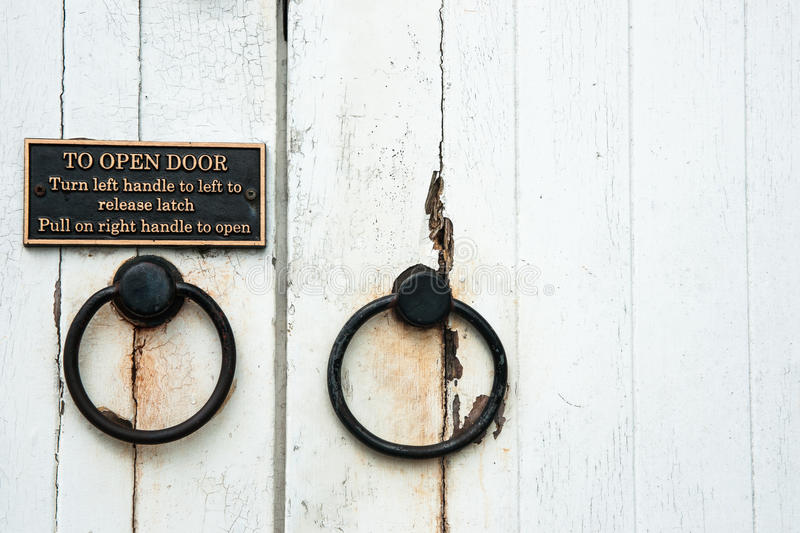 Old door handles with instructions royalty free stock image