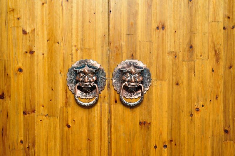 Wood Door with knocker. Old Door knocker with lion heads on wooden door stock photos