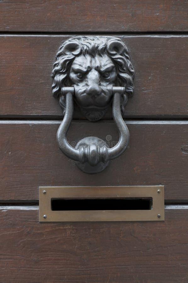 Old door knocker lion and mailbox. On the door stock photos