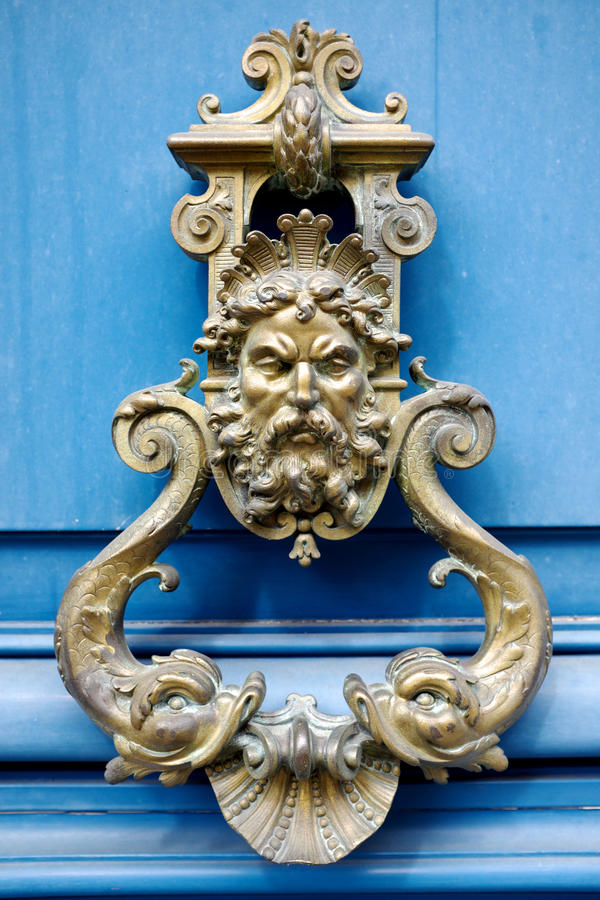 Old Door Knocker. On the streets of Paris royalty free stock image