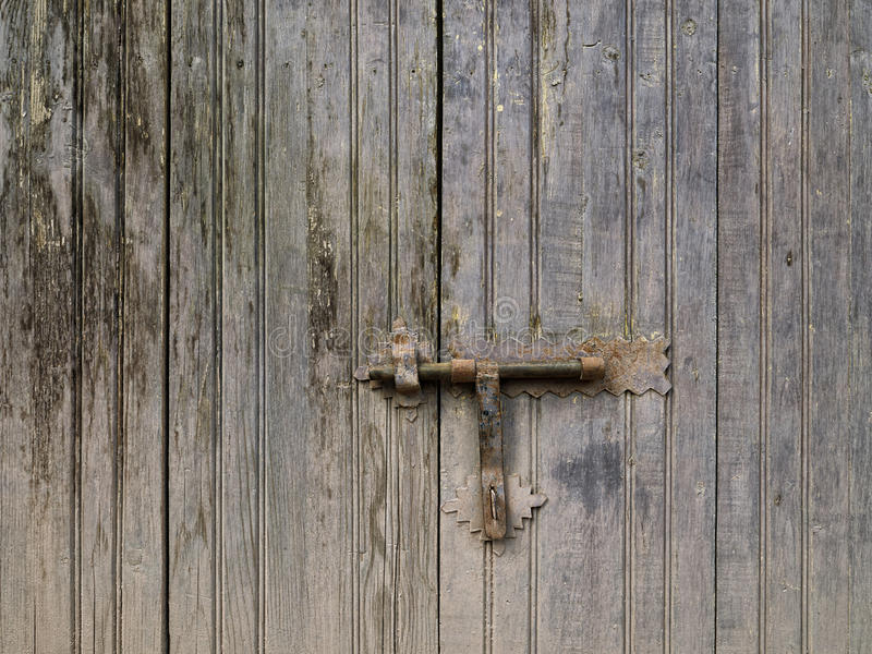 Old door lock and latch. Old door lock and rusty latch royalty free stock photo