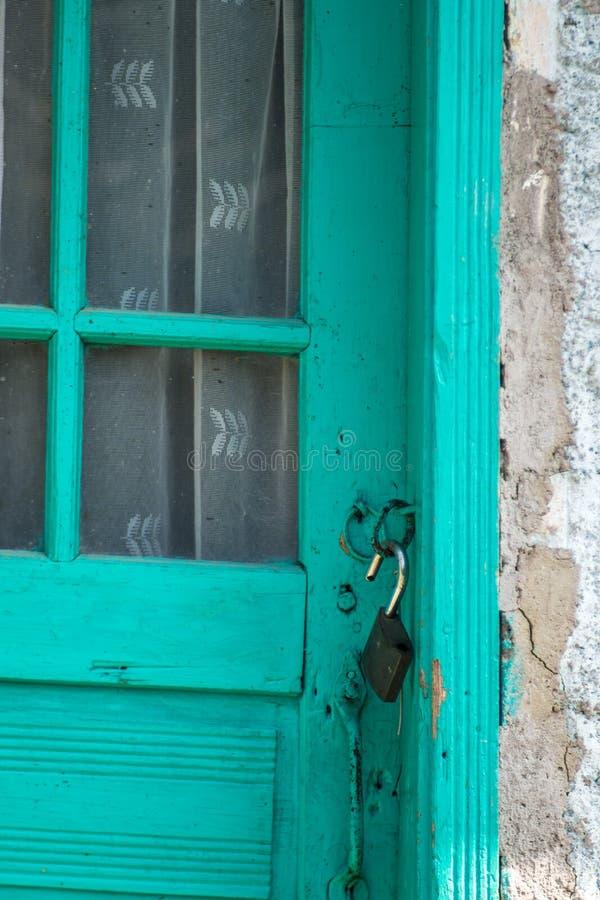 Old door locker open on a wooden door stock image