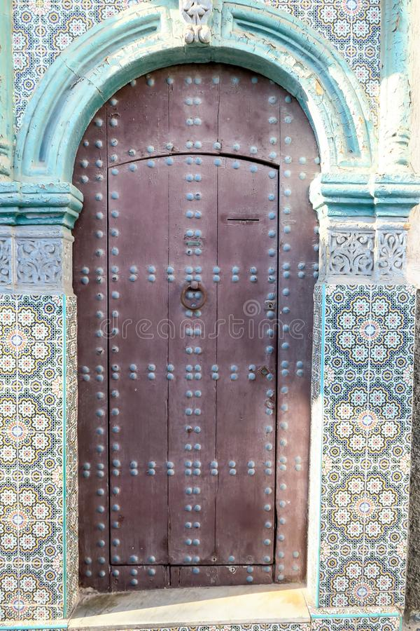old door of mosque in morocco, photo as background royalty free stock photography