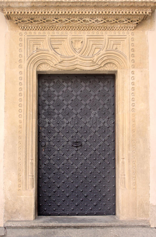 Old door with ornament in stone wall royalty free stock photo
