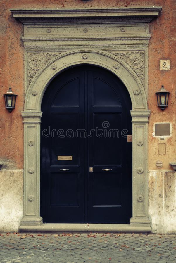 Old door, Rome, Italy. Vintage filter applied. Polaroid filter royalty free stock photos