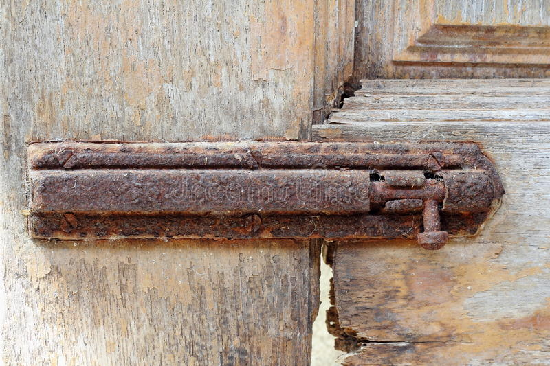 The old door safety latch royalty free stock photo