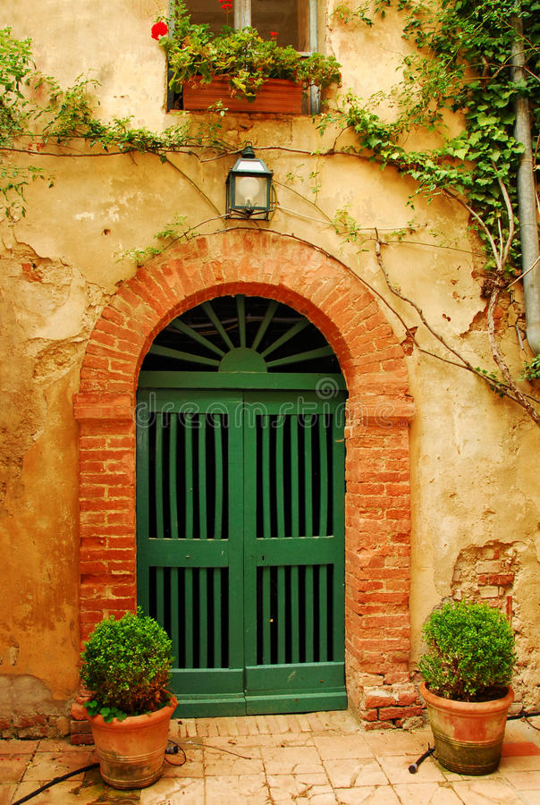 Old Door in Tuscany. A picturesque detail in the region of Tuscany in Italy