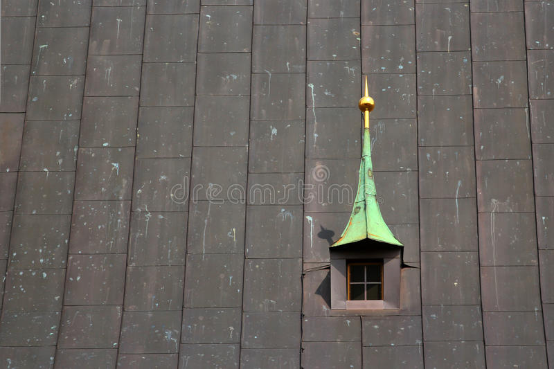 Old dorm window in metal roof of a church stock photography