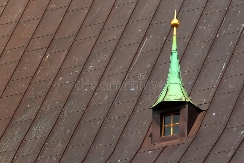 Old dorm window in metal roof of a church royalty free stock images