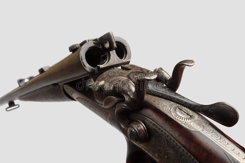 Old double-barrelled gun royalty free stock photos