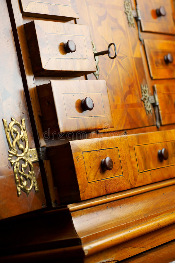 An old drawer. Detail of An old drawer with lock and key royalty free stock photos