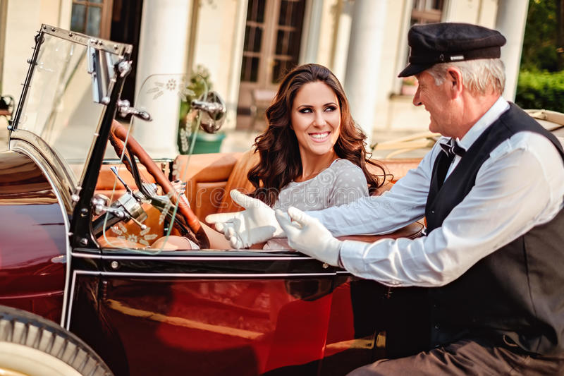 Old driver talking to a girl driver royalty free stock image