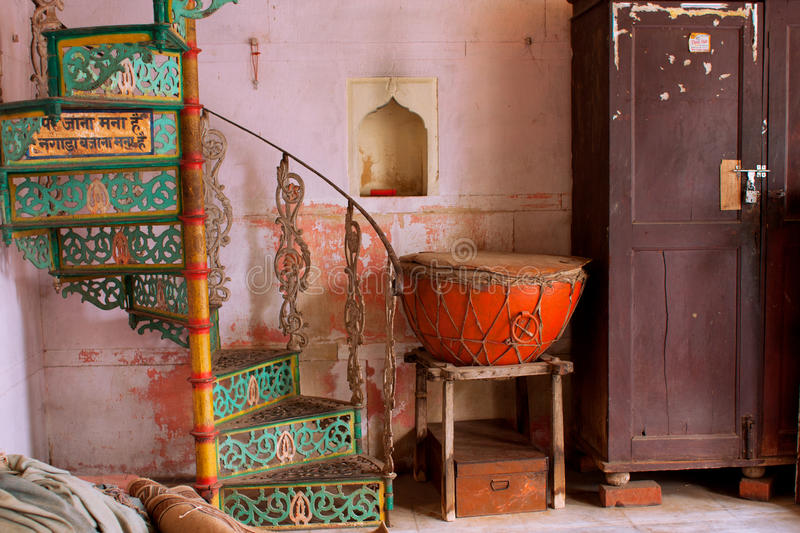 Old Drum stands at the metal spiral staircase. In the old temple in Ayodhya, India. 80% of Uttar Pradeshs population is Hindu, Muslims make up 18.4 royalty free stock photography