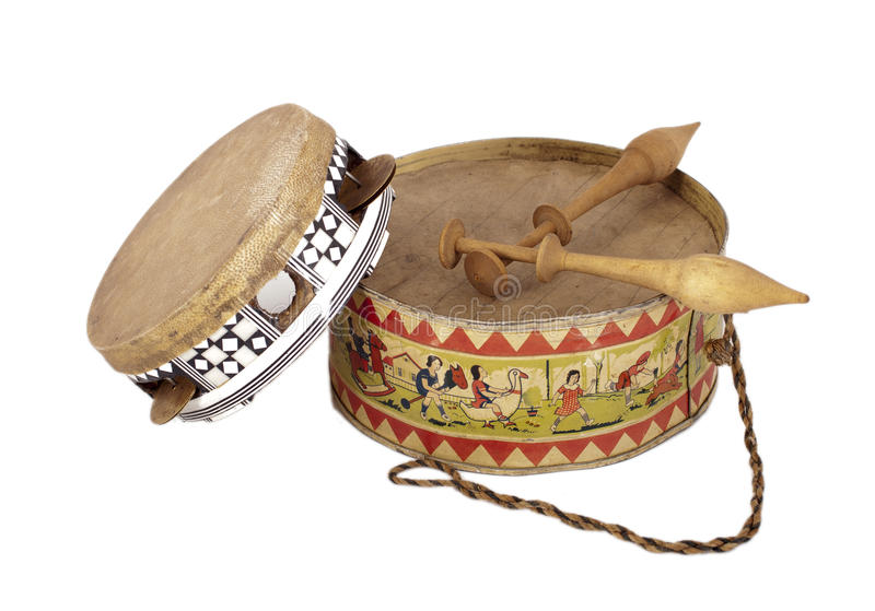 Old drum and tambourine. Solated on white background stock photo