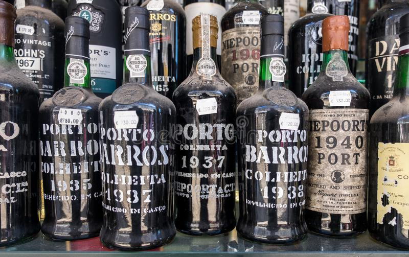 Old dusted porto wine bottles for sale at wine store. Local Market in Lisbon. Portugal royalty free stock photography