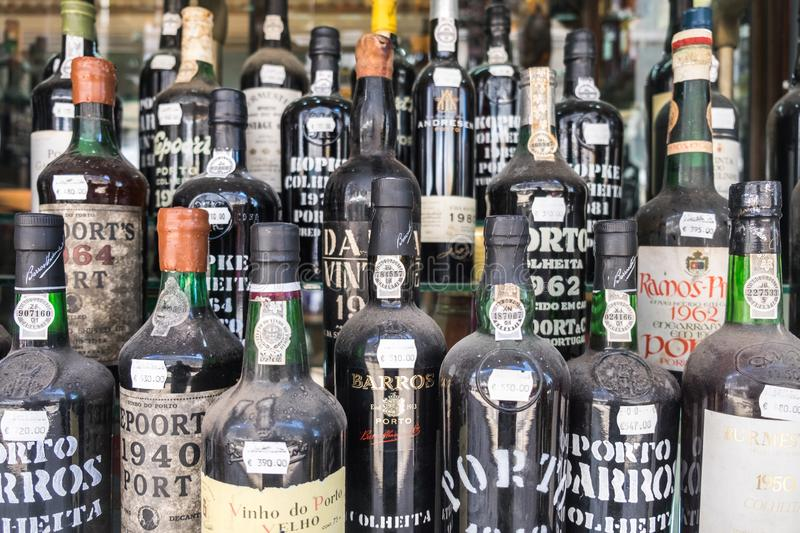 Old dusted porto wine bottles for sale at wine store. Local Market in Lisbon. Portugal stock photo