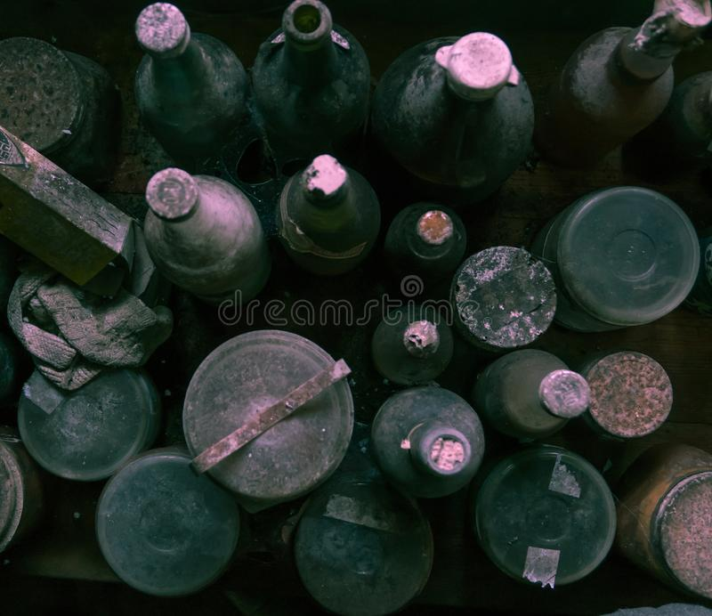 Old dusty bottles and jars photographed from above. stock photo
