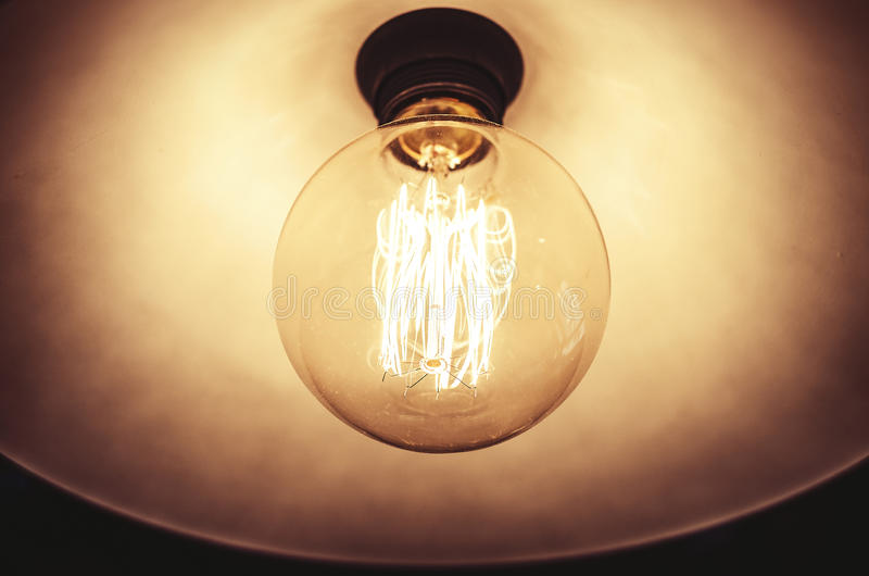Old dusty light bulb stock image