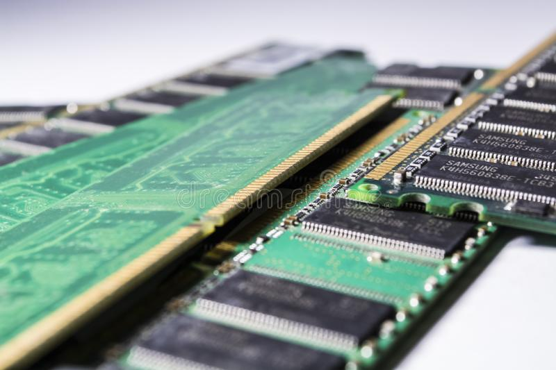 Old and dusty memory cards from the PC. Diskettes. Motherboard. Repair of the computer. Green color. Modern technologies. royalty free stock image