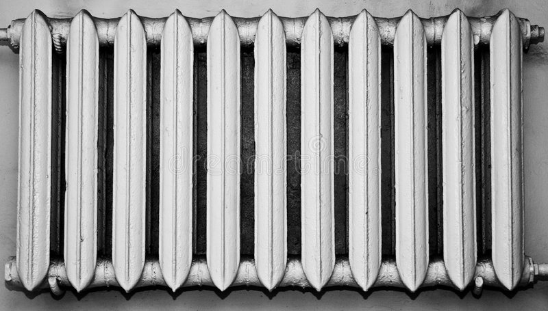Old and dusty metal radiator stock image
