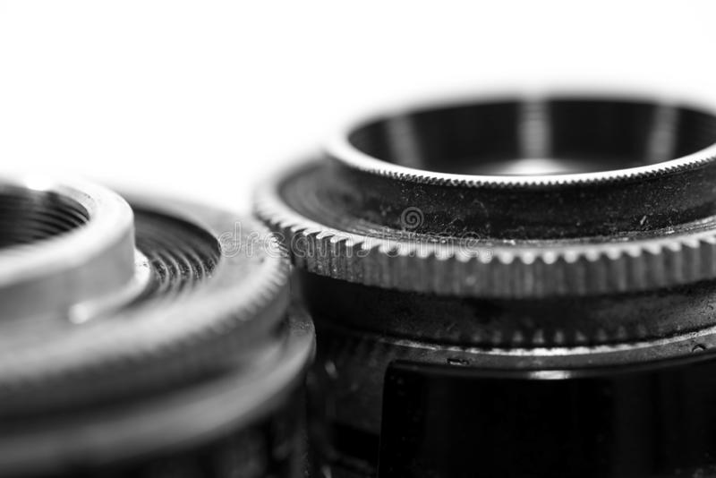 Old , dusty, vintage 120 mm film retro Soviet camera from the 1960 s. Close up detailed macro shot in black and white stock photo