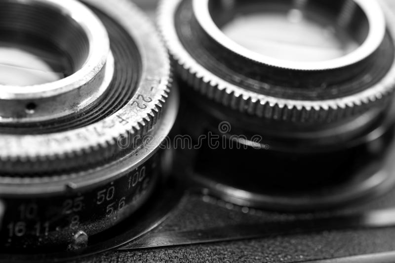 Old , dusty, vintage 120 mm film retro Soviet camera from the 1960 s. Close up detailed macro shot in black and white stock image