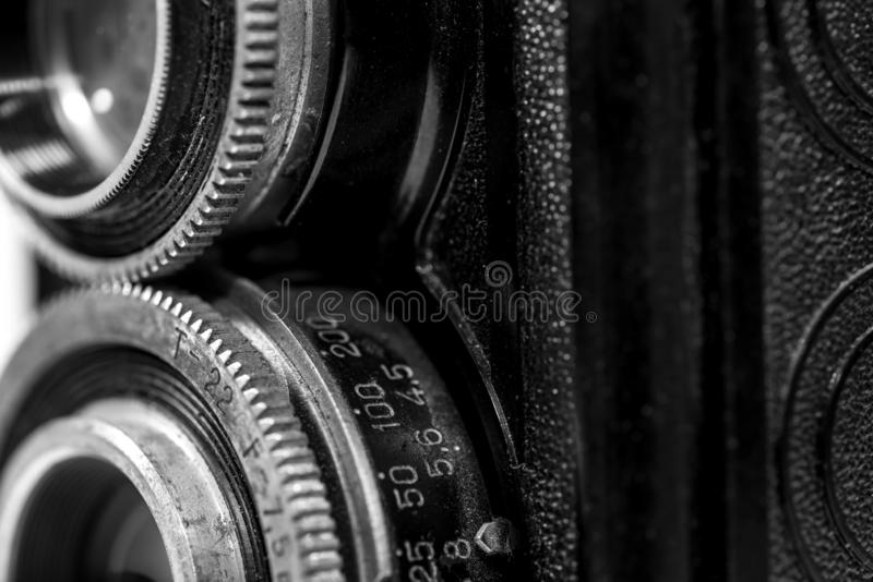 Old , dusty, vintage 120 mm film retro Soviet camera from the 1960 s. Close up detailed macro shot in black and white royalty free stock photography