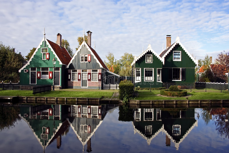 Old dutch houses in Holland. Reflecting in the canal royalty free stock image