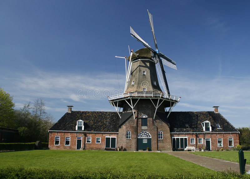Download Old Dutch Oil And Grain Mill Stock Image - Image of green, high: 2262831