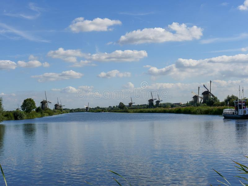 Old Dutch Windmill in beautiful shot. In the beautiful wetlands around Dordrecht, you will find the windmills of Kinderdijk. Nineteen beautiful windmills, built royalty free stock images