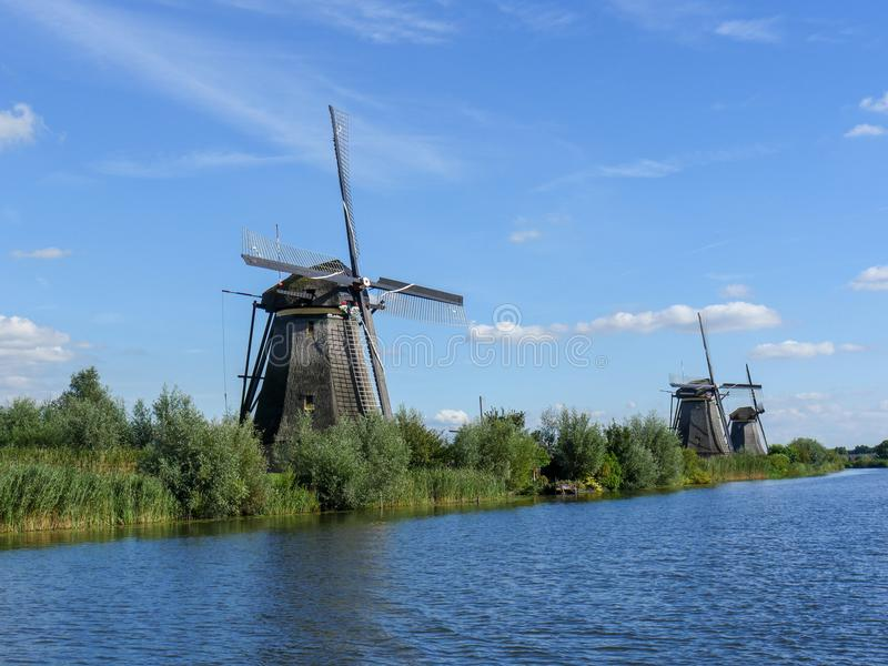 Old Dutch Windmill in beautiful shot. In the beautiful wetlands around Dordrecht, you will find the windmills of Kinderdijk. Nineteen beautiful windmills, built royalty free stock image