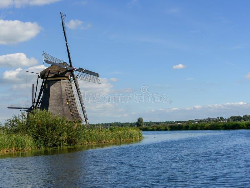 Old Dutch Windmill in beautiful shot. In the beautiful wetlands around Dordrecht, you will find the windmills of Kinderdijk. Nineteen beautiful windmills, built royalty free stock photo