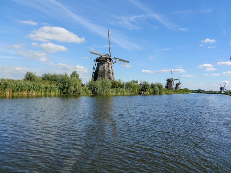 Old Dutch windmill in beautiful shot. In the beautiful wetlands around Dordrecht, you will find the windmills of Kinderdijk. Nineteen beautiful windmills, built stock image