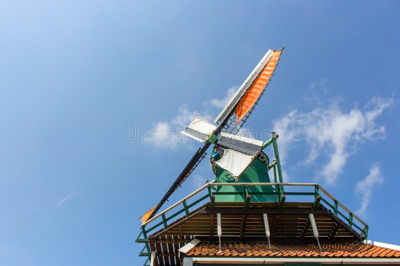 Old dutch windmill in Netherlands. Windmill against blue sky with clouds. Historic architecture in Europe. Rural holland landmark. royalty free stock photo