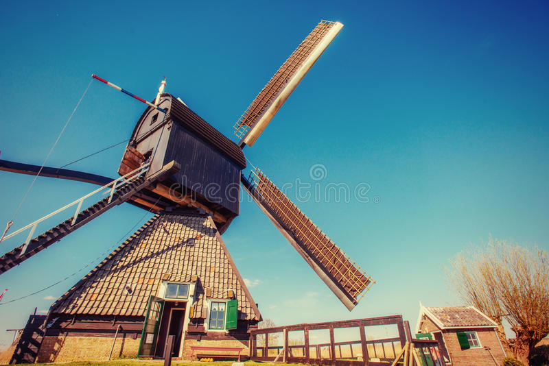 Old Dutch windmills spring from the canal in Rotterdam. Holland. Old Dutch windmills spring from the canal in Rotterdam. Holland royalty free stock photography