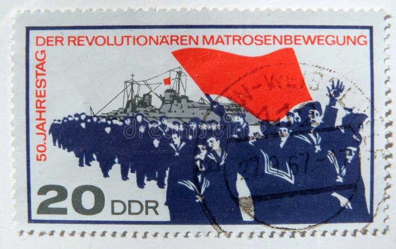 An old east german postage stamp celebrating the german naval revolt of 1917. Leeds, England - April 18 2018: An old east german postage stamp celebrating the stock photography