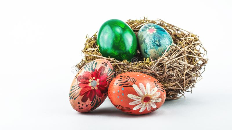 Old Easter eggs in bird nest. royalty free stock image