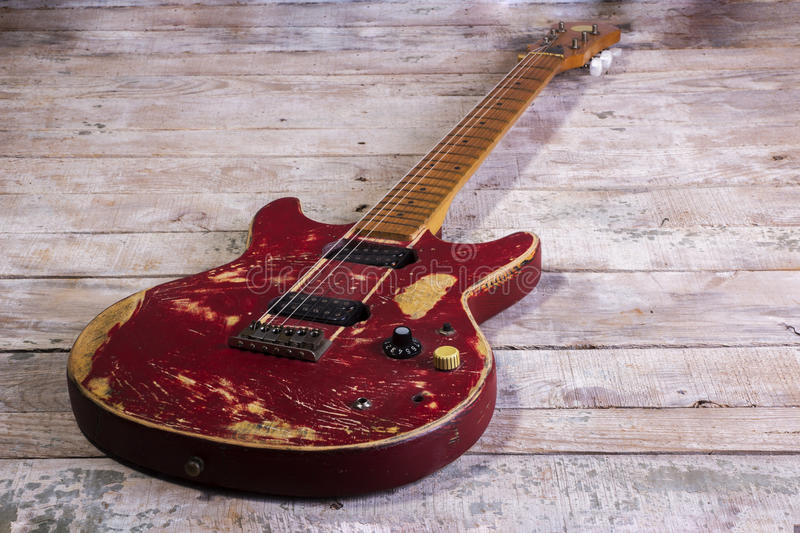 Old electric guitar red. Isolated on wood stock image