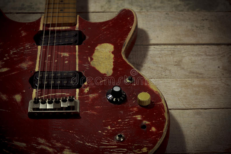 Old electric guitar red. Isolated on wood stock photos
