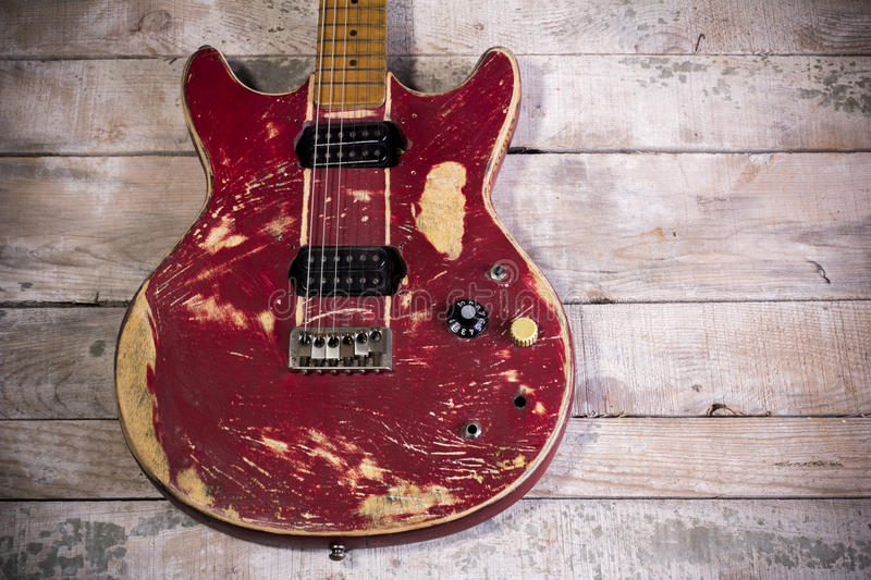 Old electric guitar red. Retro isolated on wood royalty free stock photography